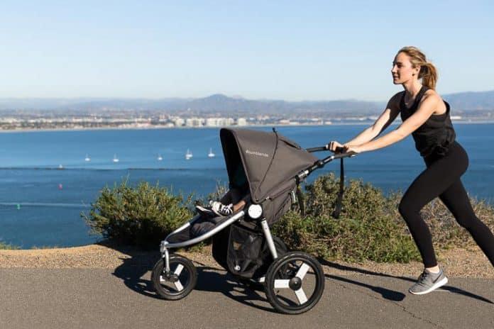 women jogs with kid