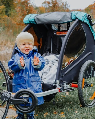 Kid in Rain with Stroller
